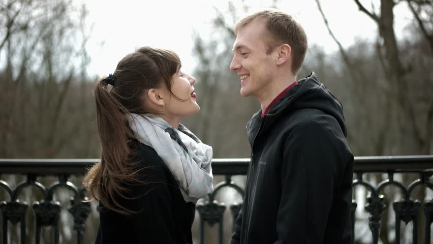 Couple in love kissing. A loving couple walking in the park. Portrait of a white European couples in love. Beautiful guy and girl. Loving couple smiling. The embrace of a couple in love. | Shutterstock HD Video #1009742153