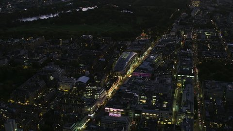 Aerial overhead night view City of London street lights Oxford Street to Marble Arch Hyde Park England UK RED WEAPON