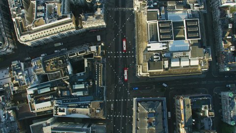 Aerial overhead view Oxford Street at sunrise retail outlet rooftops pedestrians and public transport vehicles London England UK RED WEAPON
