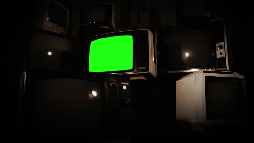 Old Tv Green Screen with Many 1980s Tvs. Zoom In. Sepia Tone. Ready to replace green screen with any footage or picture you want. | Shutterstock HD Video #1009773773