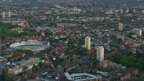 Aerial sunset view London cityscape The Oval cricket ground MI6 Building commuter vehicles and public transport England UK