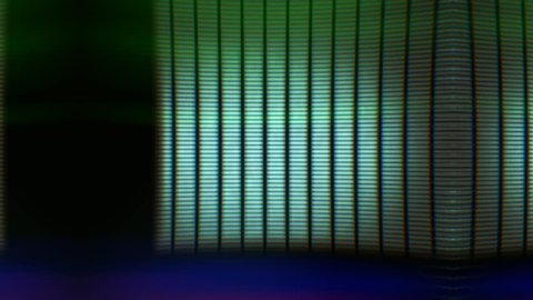 Analogue glitchy flickering colored raster lines. Glitch loop depicting technical faults or damage on retro CRT television screen for vintage technology video transitions. Loop-ready extreme close-up.