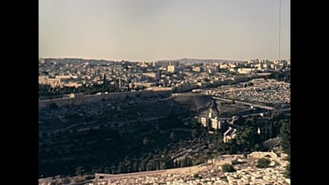 Aerial view close up of Dome of the Rock of Islamic shrine on the Temple Mount and walls of the Old City of Jerusalem on 80s in Israel. Also called Qubbat As-Sakhrah. Historic restored 1980s footage.