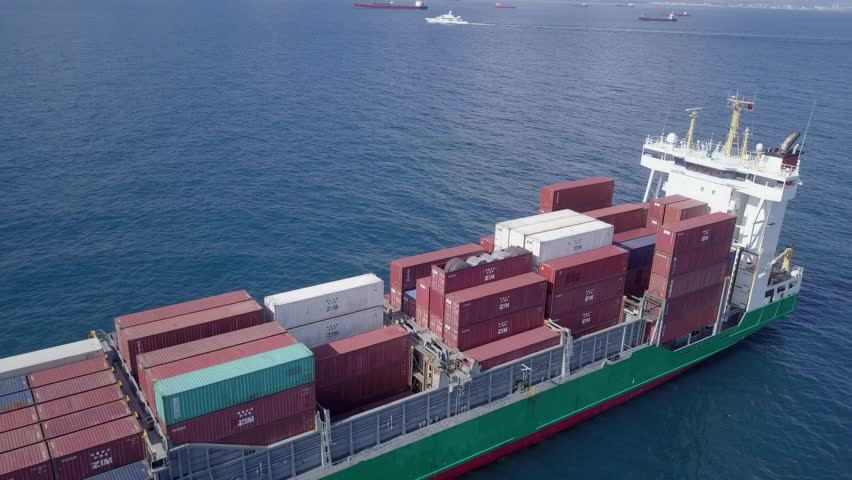 Mediterranean Sea - April 12, 2018: Aerial footage of a small container ship (Also known as Feeder) at sea.  #1009807763
