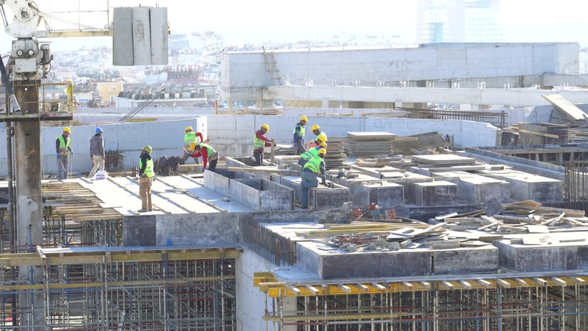 Construction workers working on building site | Shutterstock HD Video #1009841693