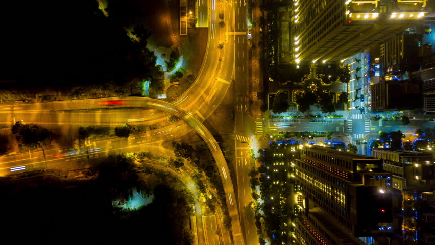 night and day illuminated taipei downtown traffic crossroad and road junction aerial down view 4k timelapse taiwan