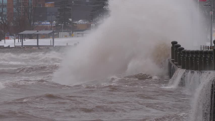 Massive waves crash into shore in typhoon and hurricane force wind storm | Shutterstock HD Video #1009893413