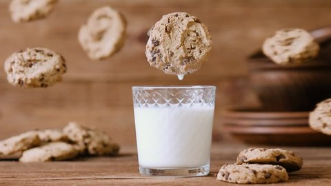 Cinemagraph - Cookie falls into the glass of milk. Nobody. Motion Photo.