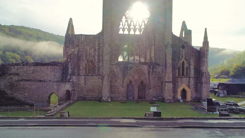 Amazing aerial drone footage of the old ruins of Tintern Abbey, in the village of Tintern in Monmouthshire, Wales. It lies on the Welsh banks of the River Wye.