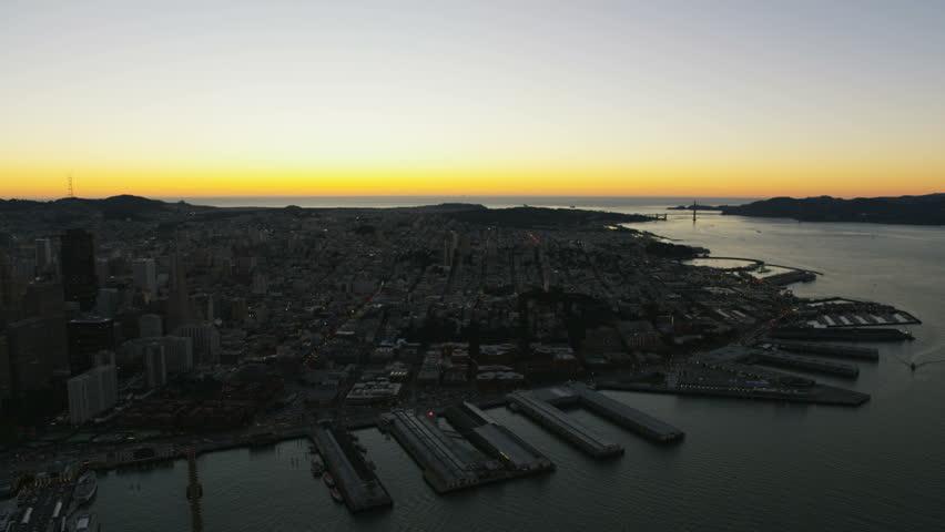 Aerial night illuminated cityscape view of San Francisco Bay Fishermans Wharf Pier 39, Marina district Golden Gate Marin Headlands California America