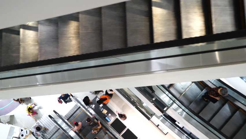 Mall Center Escalators, people going to shopping. | Shutterstock HD Video #1009933133