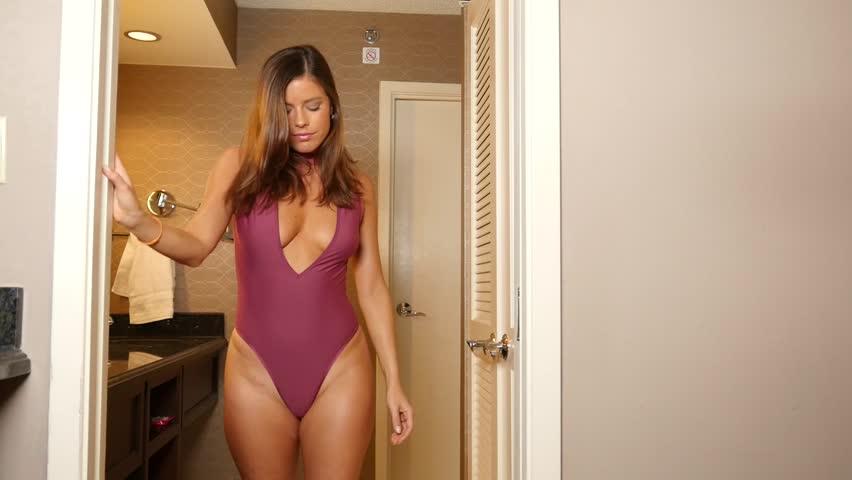 Lingerie Fitness Woman In Doorway In Sexy Burgundy Bodysuit Slow Motion Video