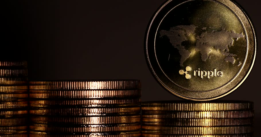 4K Physical metal golden Ripplecoin currency rotating over others coins. Worldwide virtual internet money. Digital Ripple coin cyberspace, cryptocurrency XRP. | Shutterstock HD Video #1009942553