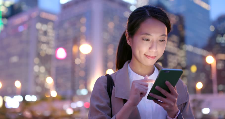 Business woman work on mobile phone at night   Shutterstock HD Video #1009966493