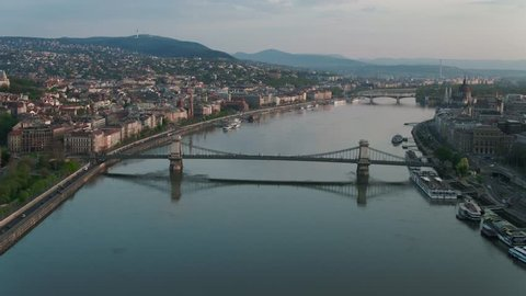 Sunrise over downtown Budapest, Buda Castle and the Danube river - aerial video