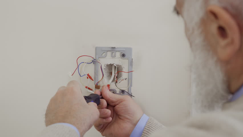 Electrician untist nuts and install intercom