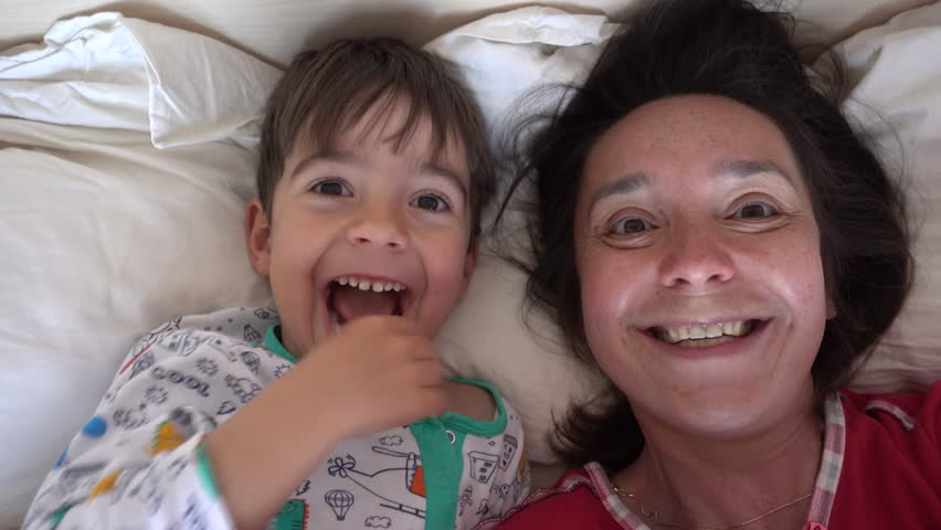 4K Selfie son drags away his mothers nose in the bed