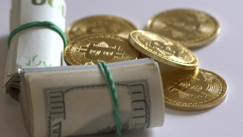 Gold bitcoin roll and rotate on a money background. Dollar,euro | Shutterstock HD Video #1009998623