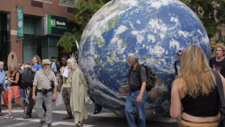 NEW YORK CITY, UNITED STATES - SEPTEMBER 21, 2014 - People carrying a large earth down the streets at the People's Climate March, a large-scale activist event against climate change.