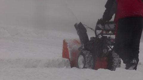 snowblowing in the winter blizzard