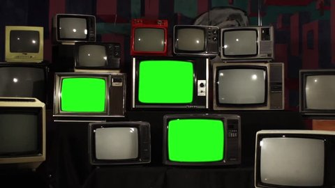 Aesthetic Televisions of the 80s with Green Screens that Turn Off. Zoom Out. Ready to replace green screen with any footage or picture you want.