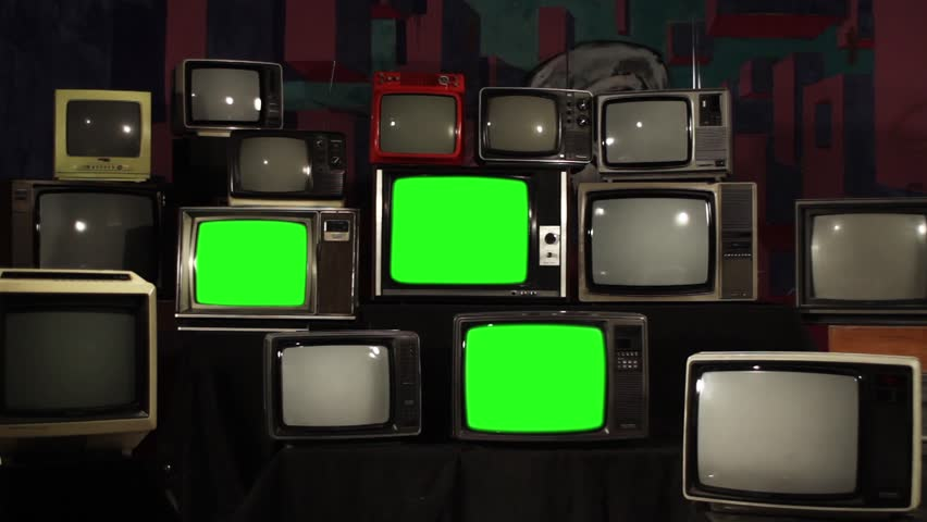 Aesthetic Televisions of the 80s with Green Screens that Light Up. Zoom In. Ready to replace green screen with any footage or picture you want.  | Shutterstock HD Video #1010055353