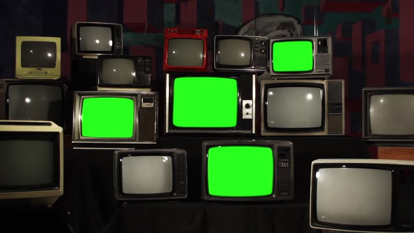 "Old 80s TVs turning on Green Screens. Zoom In. You can Replace Green Screen with the Footage or Picture you Want with ""Keying"" effect in After Effects (check out tutorials on YouTube). 