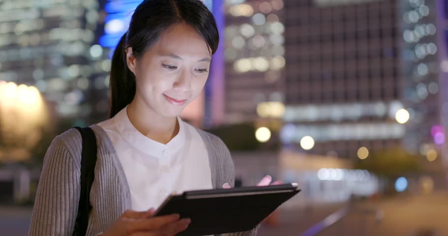 Business woman use of tablet computer at night | Shutterstock HD Video #1010055383