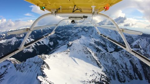 Snow Mountain Summit Closeup Peak Flyover in Helicopter View From Skids Epic Best Aerial Winter Landscape
