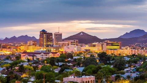 Tucson, Arizona, USA downtown skyline with Sentinel Peak from day to night.