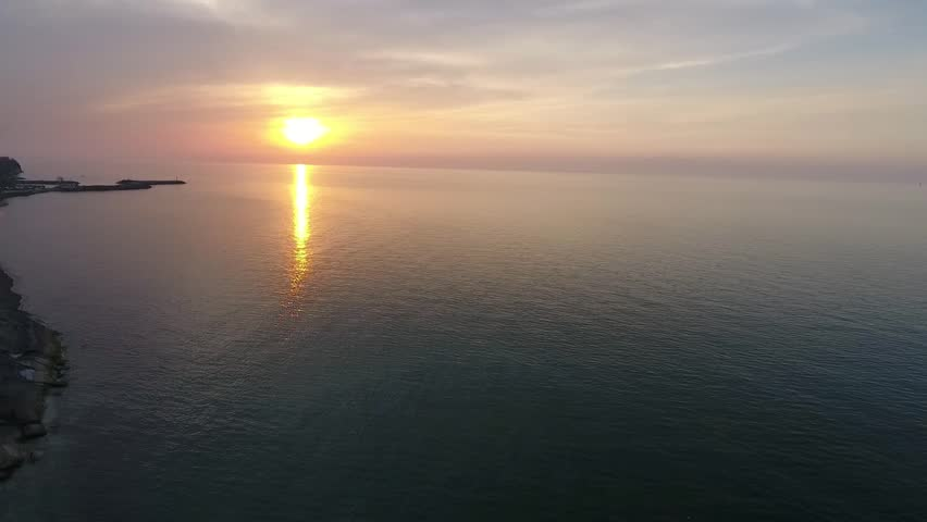 Shot of a beautiful summer sunset at the beach. Sunset at sea drone footage   | Shutterstock HD Video #1010117963