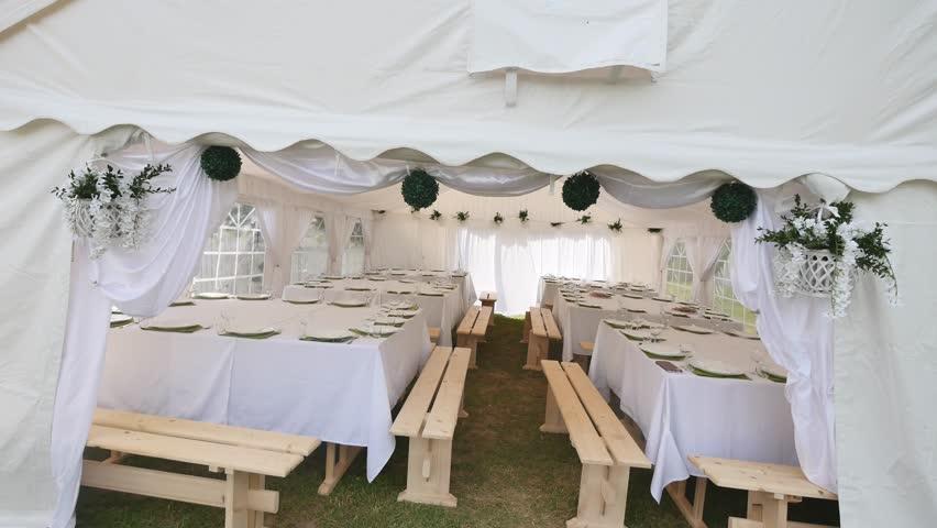 Beautiful Banquet hall under a tent for a wedding reception | Shutterstock HD Video #1010133923