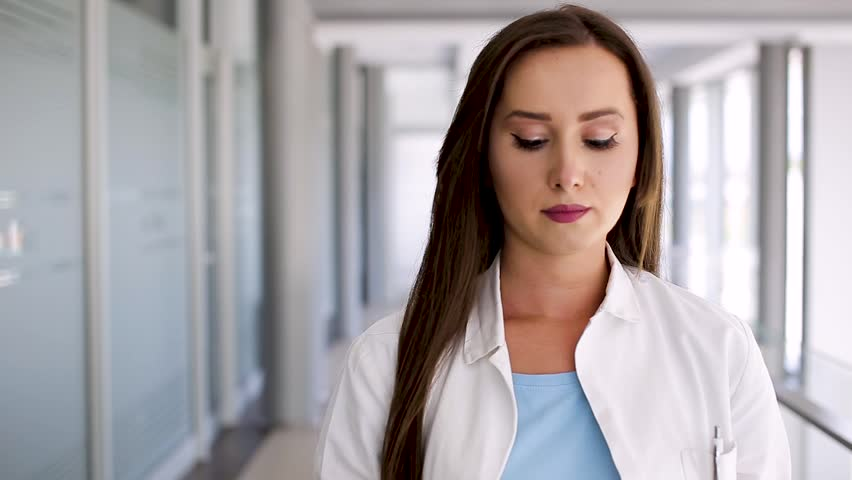 Young Beautiful Female Doctor Holds Stethoscope | Shutterstock HD Video #1010147183