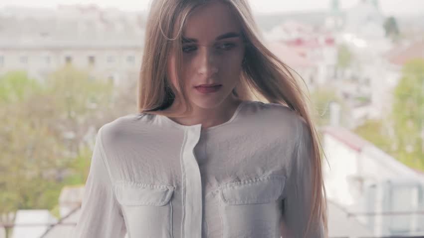 Summer lifestyle fashion portrait of young beautiful blonde stylish hipster woman wearing white shirt   Shutterstock HD Video #1010148293