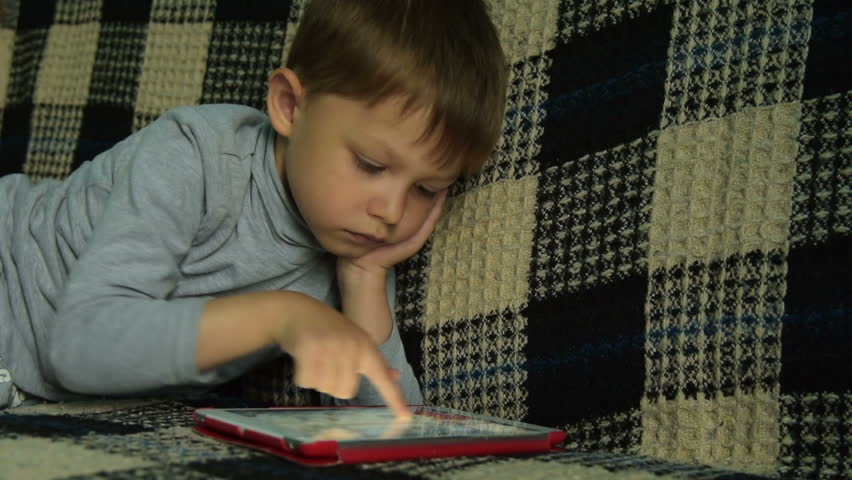 Four year old child having fun with game on tablet computer. Home leisure with touch pad | Shutterstock HD Video #1010179193