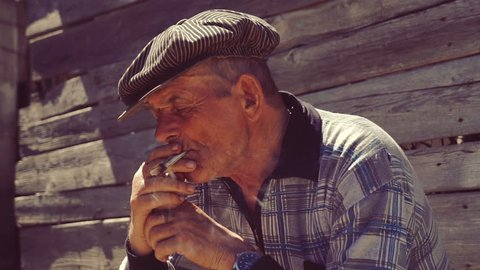 Farmer smoking a cigarette.