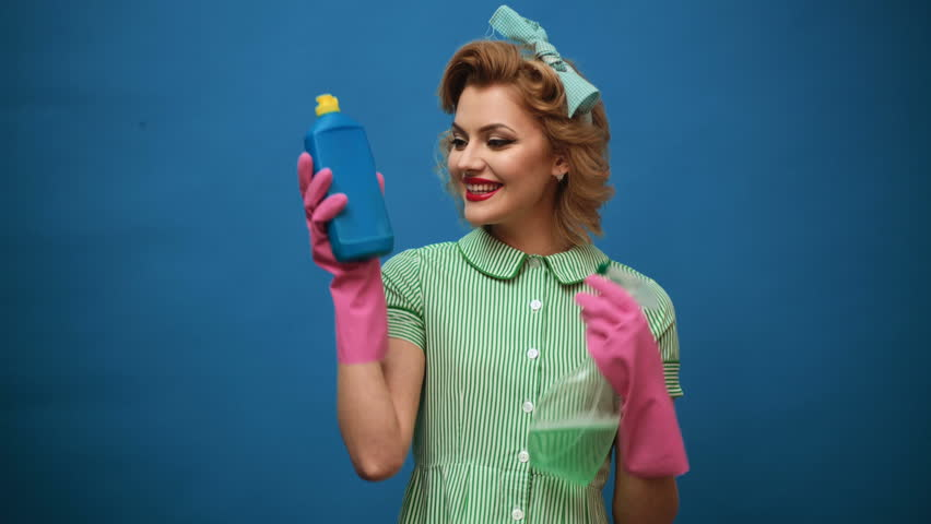 Pin up woman with cleaning equipment. Cleaning concept with supplies. Cleaning service concept. Pin up girl advertise cleaning products. Woman in gloves.   Shutterstock HD Video #1010186603