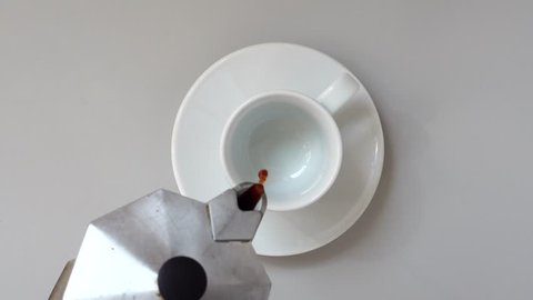 Pouring Coffee In a Cup. Gray table. Top view