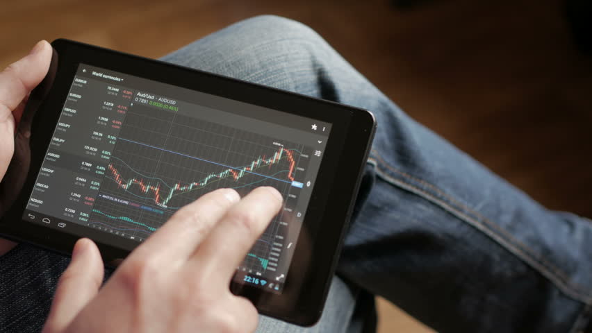 Stock market, trading online, trader working with tablet on stockmarket trading floor. Man touching screen, browse foreign exchange market data, chart. Forex. Crypto currency. Bitcoin cryptocurrency. | Shutterstock HD Video #1010241863