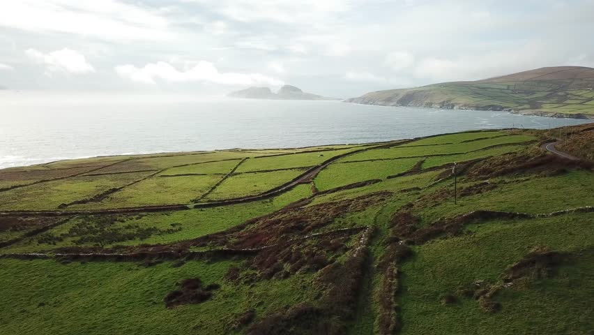 Aerial drone footage (moving forward) of small islands and flat land in Ireland, along the Irish West Coast | Shutterstock HD Video #1010253083