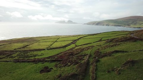 Aerial drone footage (moving forward) of small islands and flat land in Ireland, along the Irish West Coast