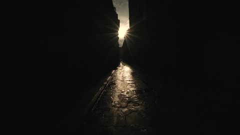 Incredible tracking shot through a narrow alleyway in Florence silhouetted by a heavenly golden sunset