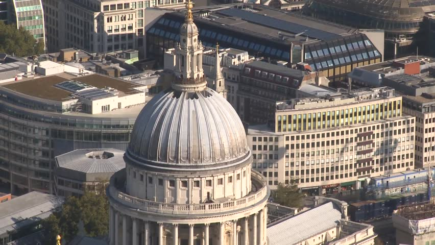 A wide aerial shot travelling over the top of St Paul's Cathedral dome on a sunny day in London. The footage shows the famous architecture close up. HD shot from a helicopter on a sunny day. | Shutterstock HD Video #1010298143