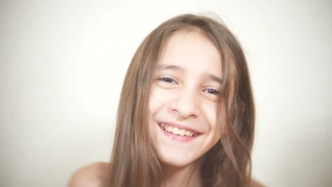 Young cheerful girl looks at the camera. smile closeup 4k