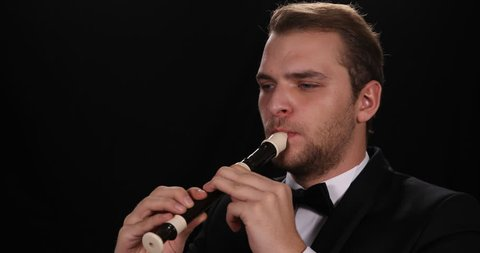 Portrait of Instrumentalist Flutist Man Playing Recorder Flute Music Orchestra