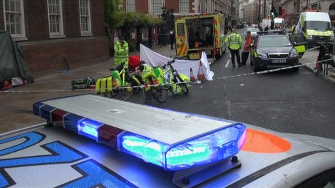 London, United Kingdom (UK) - 05 09 2012: Police guard crime scene where a dead man lies on a stretcher