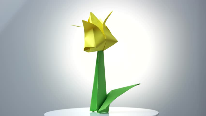 Origami flower stock video footage 4k and hd video clips yellow origami tulip flower beautiful spring plant made from paper easy instructions for creating mightylinksfo