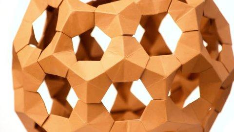 Close up modular origami ball. Modular origami cosmic body. Captivating japanese paper art.