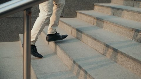 Walking upstairs: close-up view of man's leather shoes business stairs run walk