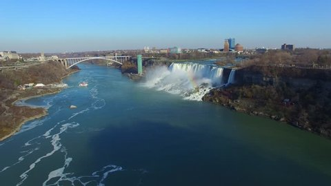Drone taking off in Niagara Falls and flying towards wide river